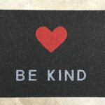 BE KIND-grey on black w red heart