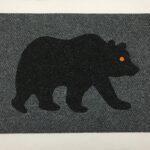 BEAR-black on grey w orange eye