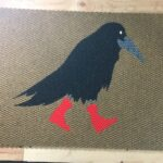 CROW-black on tan w red boots
